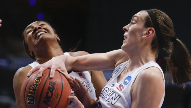Connecticut players Morgan Tuck, left, and  Breanna Stewart grab a rebound during the first half of a regional final game against Dayton in the NCAA women's college basketball tournament Monday, March 30, 2015, in Albany, N.Y. (AP Photo/Mike Groll)