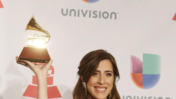 Mariana Vega poses with her award during the 15th Annual Latin Grammy Awards in Las Vegas
