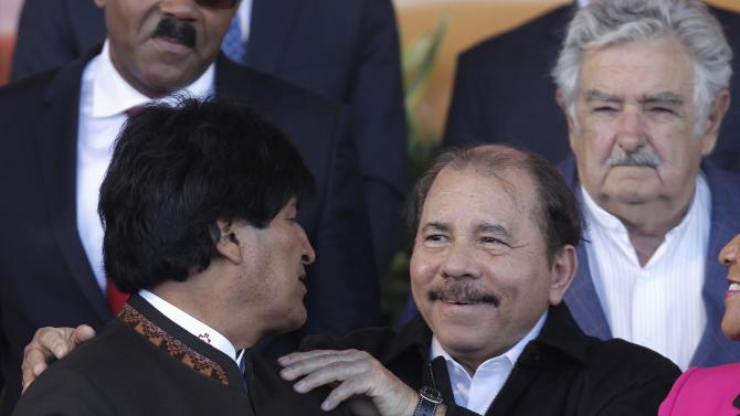 Nicaragua's President Daniel Ortega greets Bolivia President Evo Morales, during the family photo at the CELAC summit in San Antonio de Belen