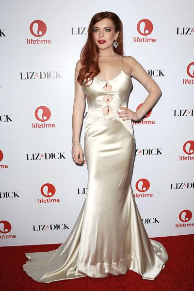 "Elizabeth Taylor she is not. Lindsay Lohan steps out in a dress that's just barely hanging on to her at the ""Liz & Dick"" premiere on Nov. 20 in Beverly Hills. The gold-champagne coloured gown squeezes"