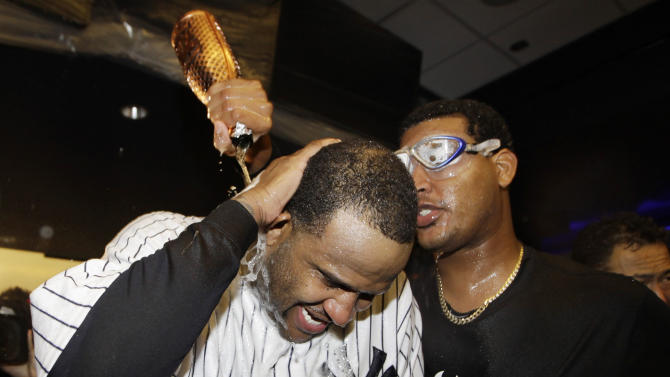 New York Yankees starting pitcher CC Sabathia is doused by teammate Ivan Nova, right, as they celebrate in the clubhouse after Game 5 of the American League division baseball series against the Baltimore Orioles, Friday, Oct. 12, 2012, in New York. The Yankees won the game 3-1 and advanced to the AL championship. (AP Photo/Kathy Willens)