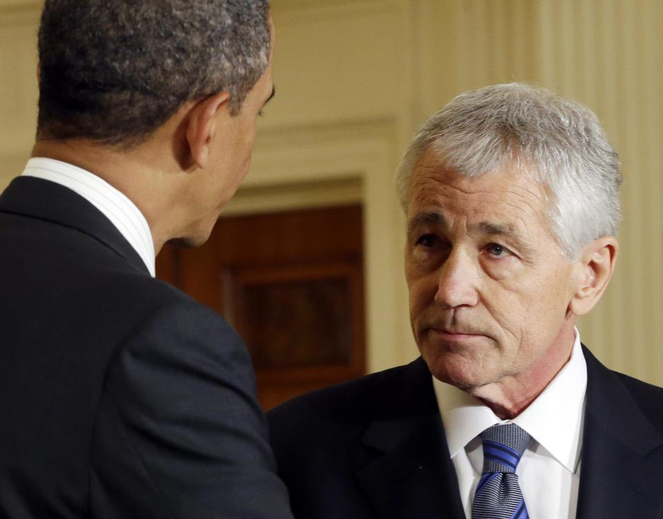 FILE - In this Jan. 7, 2013 file photo, President Barack Obama, left, shakes hands with his choice for Defense Secretary, former Nebraska Sen. Chuck Hagel, after announcing Hagel's nomination in the East Room of the White House in Washington. (AP Photo/Pablo Martinez Monsivais, File)