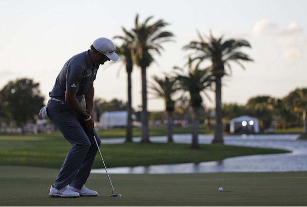 Dustin Johnson watches his putt on the 18th green during the second round of the Cadillac Championship golf tournament Friday, March 7, 2014, in Doral, Fla. Johnson bogeyed the hole