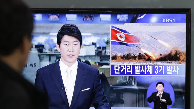 "A South Korean man watches a TV news reporting missile launch conducted by North Korea, at a Seoul Train Station in Seoul, South Korea, Saturday, May 18, 2013. North Korea fired three short-range guided missiles into its eastern waters on Saturday, a South Korean official said. It routinely tests such missiles, but the latest launches came during a period of tentative diplomacy aimed at easing tensions. The letters at a screen read "" Fired three short-range guided missiles."" (AP Photo/Ahn Young-joon)"