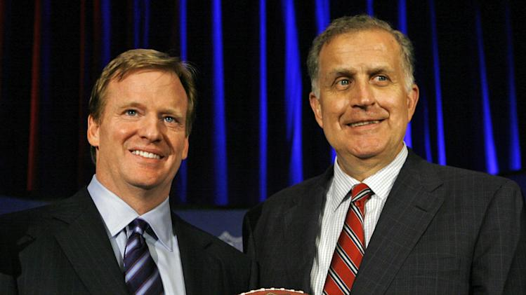FILE - In this Aug. 8, 2006 file photo, Roger Goodell, left, the NFL's chief operating officer, and Paul Tagliabue, NFL commissioner, pose for photos after Goodell was selected to succeed Tagliabue as the league's new commissioner at an NFL meeting in Northbrook, Ill. The players' union opposes former Commissioner Tagliabue hearing the appeals of the four players suspended in the Saints bounties case. In a statement Wednesday, Oct. 24, 2012, the NFL Players Association said it will file a motion in U.S. District Court in New Orleans later in the day asking Tagliabue to recuse himself because of a conflict of interest.  (AP Photo/M. Spencer Green, File)