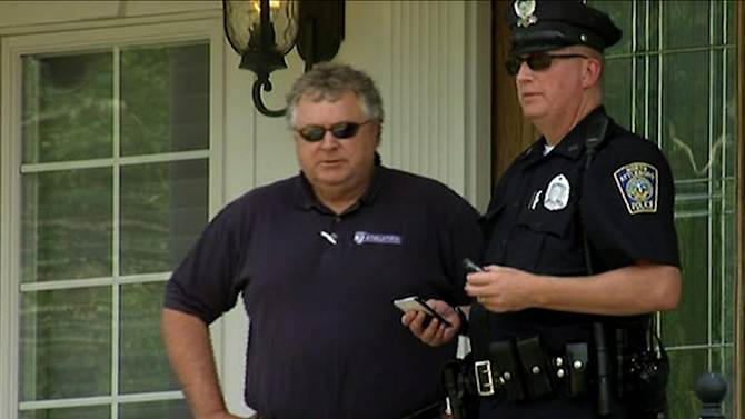 In this image taken from video, police officers talk outside of the home of New England Patriots football player Aaron Hernandez, Saturday, June 22, 2013, in North Attleboro, Mass. State police officers and dogs searched Hernandez's home as they investigate the killing of Odin Lloyd, a semi-pro football player whose body was found nearby. (AP Photo/ESPN)