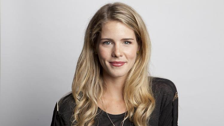 "This Aug. 22, 2013 photo shows Canadian actress Emily Bett Rickards from The CW series ""Arrow,"" in New York, premiering its new season on Oct. 9 at 8 p.m. EST. (Photo by Amy Sussman/Invision/AP)"