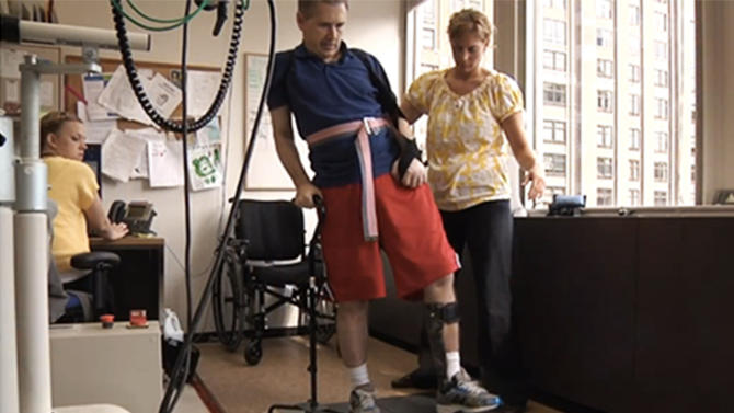 FILE - A  2012 file photo of an image taken from video and provided by Sen. Mark Kirk's office shows Sen. Mark Kirk, R-Ill. going through a walking exercise at the Rehabilitation Institute of Chicago following a stroke.  Nearly a year after a stroke left him barely able to move the left side of his body, U.S. Sen. Mark Kirk is expected to climb the 45 steps to the Senate's front door this week _ a walk that is significant not just for Illinois' junior senator, but also for medical researchers and hundreds of thousands of stroke patients. (AP Photo/Courtesy of Sen. Mark Kirk's office)