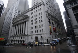 The streets surrounding the New York Stock Exchange are deserted as financial markets remain closed for the second day due to superstorm Sandy, Tuesday, Oct. 30, 2012. Superstorm Sandy could mean a slower economy and higher gas prices in coming months, though reconstruction will help cushion the economic blow (AP Photo/Richard Drew)