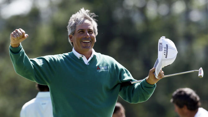 Fred Couples celebrates after finishing the second round the Masters golf tournament on the 18th hole Friday, April 6, 2012, in Augusta, Ga. (AP Photo/David J. Phillip)