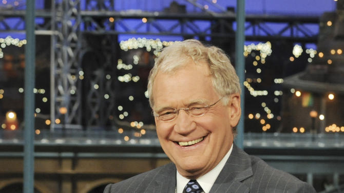 "FILE - In this April 21, 2010 file photo released by CBS, host David Letterman is shown on the set of the ""Late Show with David Letterman, in New York. Letterman is back at ""Late Show"" Monday, Aug. 22, 2011, after a two-week vacation, his first day at work since a threat against his life was posted on a website. Last week, a frequent contributor to a jihadist website posted a threat to Letterman. He urged Muslim followers to ""cut the tongue"" of the late-night host because of a joke the comic had made about al-Qaida leaders on his CBS show. (AP Photo/CBS, Heather Wines) MANDATORY CREDIT; NO SALES; NO ARCHIVE; NORTH AMERICAN USE ONLY"