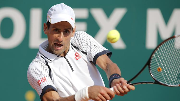 Novak Djokovic of Serbia plays a return to Juan Monaco of Argentina during their match of the Monte Carlo Tennis Masters tournament in Monaco, Thursday, April 18, 2013. (AP Photo/Lionel Cironneau)