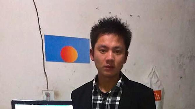 In this photo taken with mobile phone camera and released by Zhang Hongming, Zhang poses with his personal computer, which he runs the popular fan page for the Communist Party's General Secretary Xi Jinping, at an apartment in the city of Wuxi in eastern China, Saturday, Feb. 9, 2013. For weeks, the mysterious microblog has been lifting a veil from around China's new leader Xi with candid snapshots from his travels that defy the typically stiff and staged images of the leadership in state media. (AP Photo) EDITORIAL USE ONLY, NO SALES