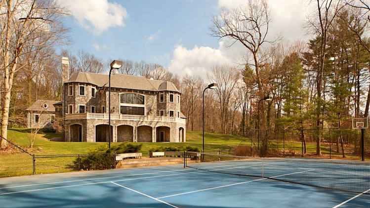 An American 'palace' with a pool at its heart tennis court