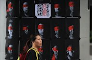 A woman protests against the local government's plans to implement mandatory Chinese patriotism lessons at schools in Hong Kong