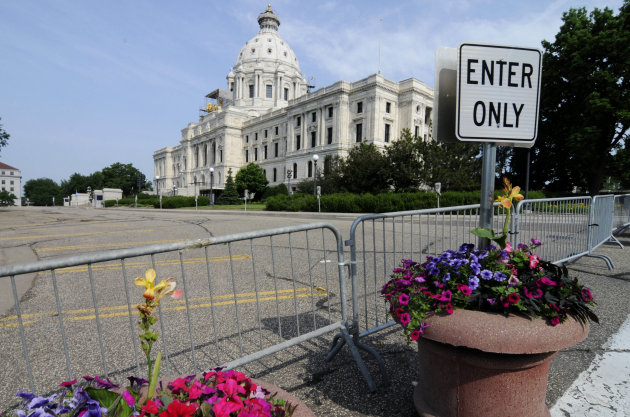 Barriers were in place on the road in front of the Minnesota State Capitol Friday, July 1, 2011 in St. Paul, Minn., after negotiations over the state budget between Republican lawmakers and Democratic Gov. Mark Dayton broke down and the government shutdown at midnight. AP Photo/Jim Mone)