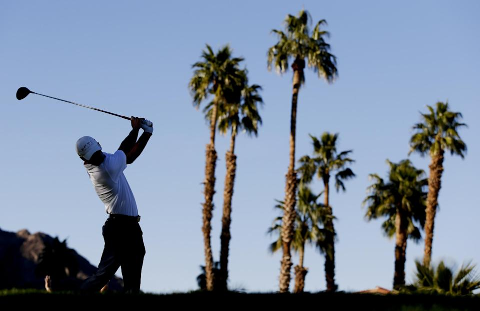Charles Howell III hits his tee shot on the 18th hole during the final round of the Humana Challenge golf tournament on the Palmer Private course at PGA West in La Quinta, Calif., Sunday, Jan. 20, 2013. (AP Photo/Chris Carlson)
