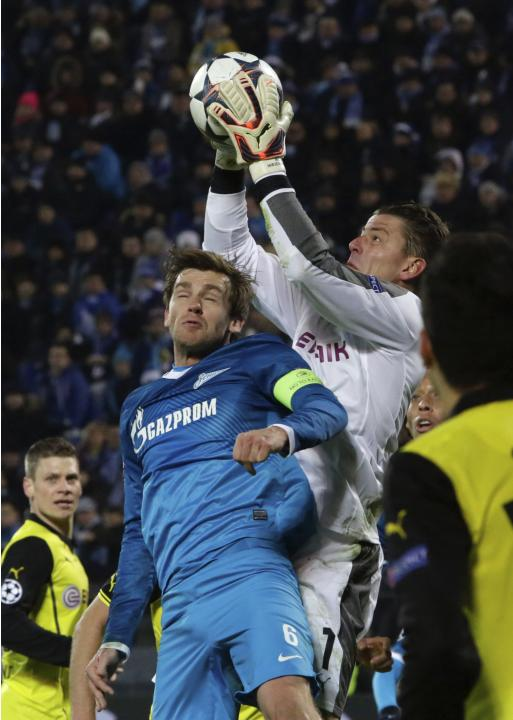 Zenit St Petersburg's Lombaerts fights for the ball with Borussia Dortmund's Weidenfeller during their Champions League soccer match in St. Petersburg