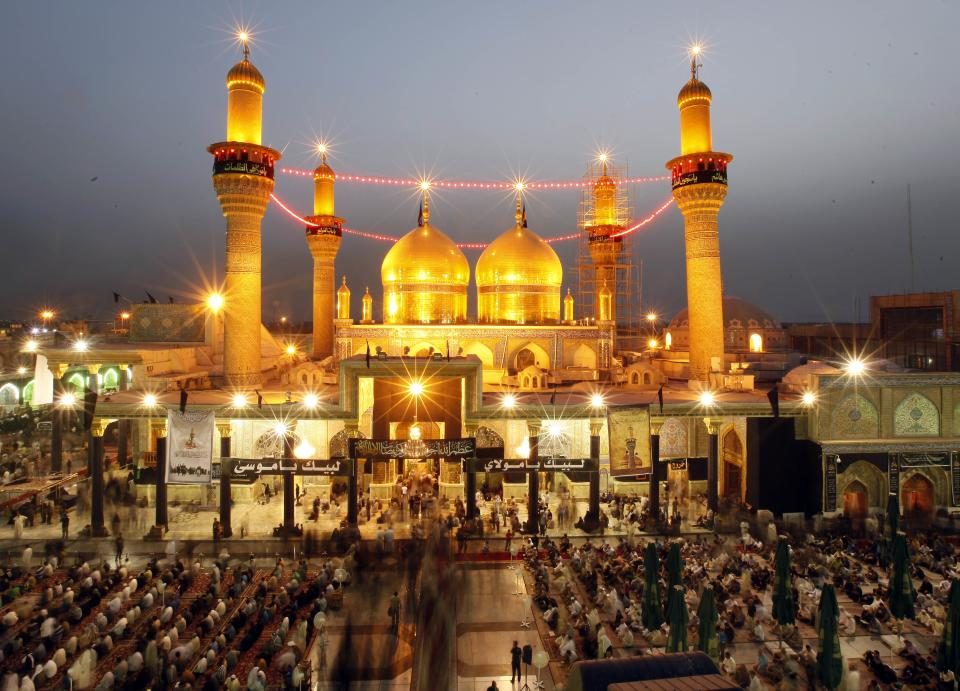 Shiite pilgrims gather at the Imam Moussa al-Kadhim shrine during the preparations for the annual commemoration of the saint's death in the Shiite district of Kazimiyah, in Baghdad, Iraq, Monday, June 3, 2013. (AP Photo/ Hadi Mizban)