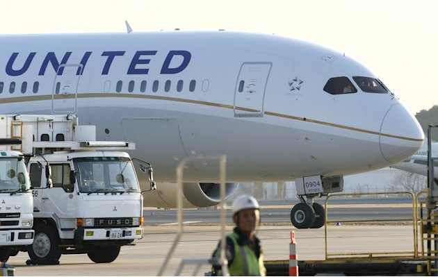 FILE - In this Thursday, Jan. 17, 2013 file photo, a United Airlines Boeing 787 is parked at Narita international airport in Narita, east of Tokyo. United Airlines is getting its 787s back in the air.