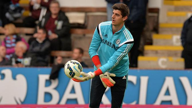 Chelsea's Belgian goalkeeper Thibaut Courtois warms-up ahead of the English Premier League football match between Burnley and Chelsea at Turf Moor in Burnley, north west England on August 18, 2014