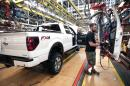 Dan Fortune installs a door install on a Ford F-150 truck on the assembly line at the Ford Dearborn Truck Plant June 13, 2014