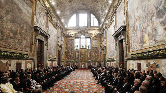 "Pope Benedict XVI delivers his speech during an audience with foreign ambassadors to the Holy See, at the Vatican, Monday, Jan. 7, 2013. The pontiff urged diplomats to supply urgent aid to Syria to relieve civilian suffering, while expressing hope that Jerusalem would become ""a city of peace and not of division."" (AP Photo/Giampiero Sposito, Pool)"