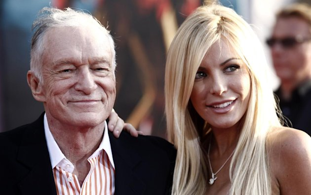 FILE - In this April 26, 2010 file photo, Hugh Hefner, left, and Crystal Harris arrives at the premiere of &quot;Iron Man 2&quot; at the El Capitan Theatre in Los Angeles. The 86-year-old Playboy magazine founder exchanged vows with his &quot;runaway bride,&quot; Crystal Harris, at a private Playboy Mansion ceremony on New Year&#39;s Eve. Harris, a 26-year-old &quot;Playmate of the Month&quot; in 2009, broke off a previous engagement to Hefner just before they were to be married in 2011. (AP Photo/Matt Sayles, File)