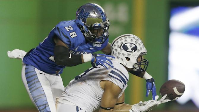 BYU wide receiver Jordan Leslie, right, is unable to hang on to a pass as Memphis defensive back Andrew Gaines (28) reaches for the ball during the second half of the in the inaugural Miami Beach Bowl NCAA college football game, Monday, Dec. 22, 2014, in Miami. Memphis defeated BYU 55-48 in two overtimes