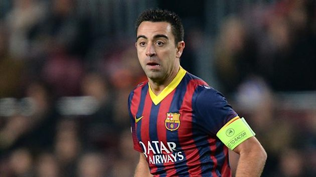 Xavi has stated that he wants to end his career at Barcelona (PA)