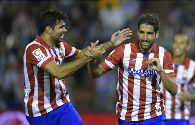 Atletico Madrid's Raul Garcia (R) celebrates his goal against Valladolid with his teammate Diego Costa (L)during their Spanish First Division soccer match at Zorrilla Stadium in Valladolid
