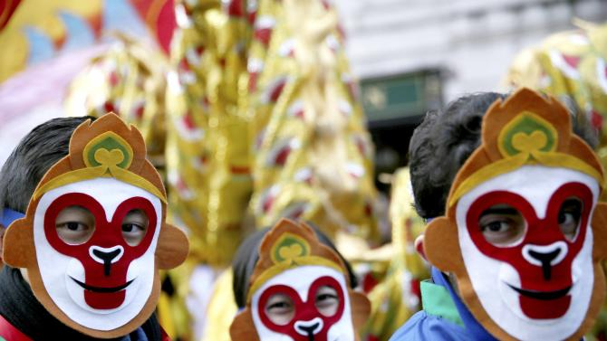 Performers wearing masks attend an event to celebrate Chinese New Year in London