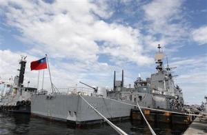 A Taiwan Navy Kidd-class destroyer Ma Kong gets ready to sail before a joint military drill in Kaohsiung port