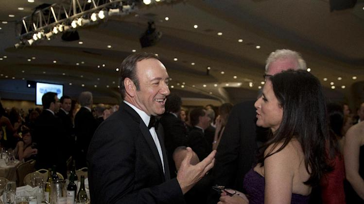"Actors Kevin Spacey, left, and Julia Louis-Dreyfus talk at the White House Correspondents' Association Dinner at the Washington Hilton Hotel, Saturday, April 27, 2013, in Washington. Spacey stars in the Washington-based Netflix series ""House of Cards,"" and Louis-Dreyfus stars as Vice President Selina Meyer in the HBO comedy ""Veep."" (AP Photo/Carolyn Kaster)"