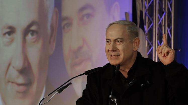 Prime Minister Benjamin Netanyahu speaks during a Likud-Yisrael Beitenu campaign rally in the port city of Ashdod, Wednesday, Jan. 16, 2013. Legislative elections in Israel will be held on Jan. 22, 2013. (AP Photo/Tsafrir Abayov)