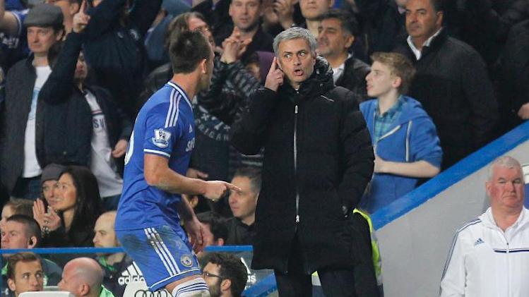 Jose Mourinho (right) gestures to Chelsea's John Terry during the Premier League game against Tottenham Hotspur at Stamford Bridge in London, on March 8, 2014