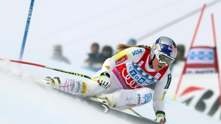 Lindsey Vonn, right, of the United States, speeds down the course on her way to win an alpine ski, women's World Cup super-G, in St. Moritz, Switzerland, Saturday, Dec .8, 2012. (AP Photo/Marco Trovati)