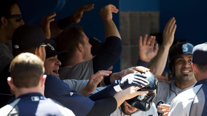 Seattle Mariners second baseman Dustin Ackley, center, celebrates his grand slam with teammates in the dugout during the fourth inning of a baseball game against the Toronto Blue Jays in Toronto on Saturday, May 4, 2013. (AP Photo/The Canadian Press, Nathan Denette)