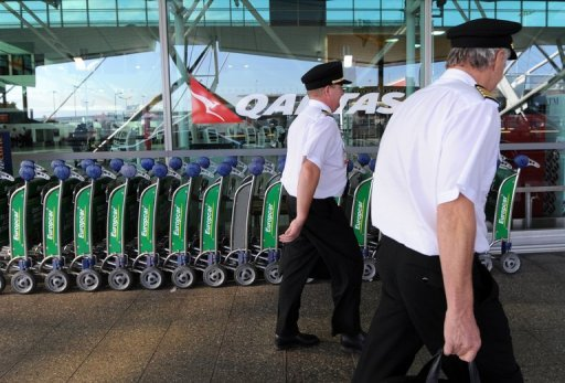 <p>This file photo shows Qantas pilots arriving for work at Sydney Airport, in 2011. Flagship Australian airline said on Thursday it was ditching the BlackBerry for Apple's iPhone after strong demand from staff, deepening woes for troubled Canadian maker Research in Motion.</p>