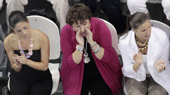 From left, Michael Phelps' girlfriend Nicole Johnson, his mother Debby and his sister Hilary sit in the stands at the FINA Swimming World Championships in Shanghai, China, Monday, July 25, 2011. (AP Photo/Gero Breloer)