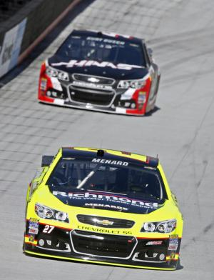 Driver Paul Menard (27) leads Kurt Busch (41) during practice for the NASCAR Sprint Cup series auto race at Bristol Motor Speedway on Friday, March 14, 2014, in Bristol, Tenn. (AP Photo/Wade Payne)