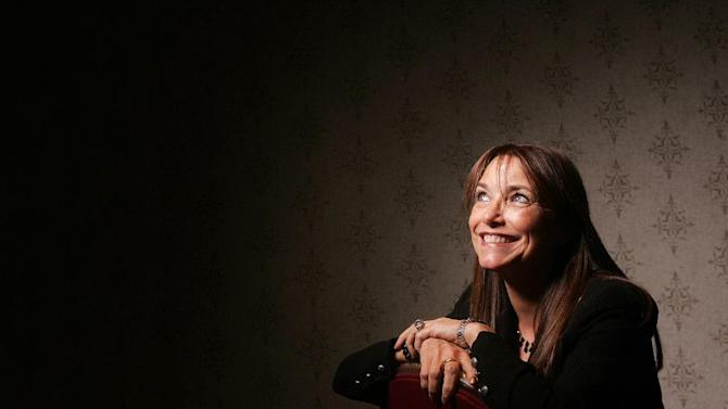 """FILE - In this Sept. 14, 2010 file photo, actress Karen Allen poses for a portrait to promote the film """"White Irish Drinkers"""" at the Toronto International Film Festival, in Toronto. Allen, perhaps best known for her role the first Indiana Jones film and the most recent sequel """"Indiana Jones and the Kingdom of the Crystal Skull,"""" will star in the American premiere of Jon Fosse's """"A Summer Day,"""" beginning in October 2012. (AP Photo/Carlo Allegri, File)"""