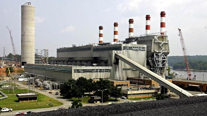 FILE- In this Aug. 7, 2007, file photo, Duke Energy's Plant Allen is shown in Belmont, N.C. Duke Energy Corp. and Progress Energy Inc. said Tuesday, July 3, 2012, they had completed their merger now valued at about $32 billion to form the nation's largest electric company. But the normally routine event came with a twist. (AP Photo/Chuck Burton)