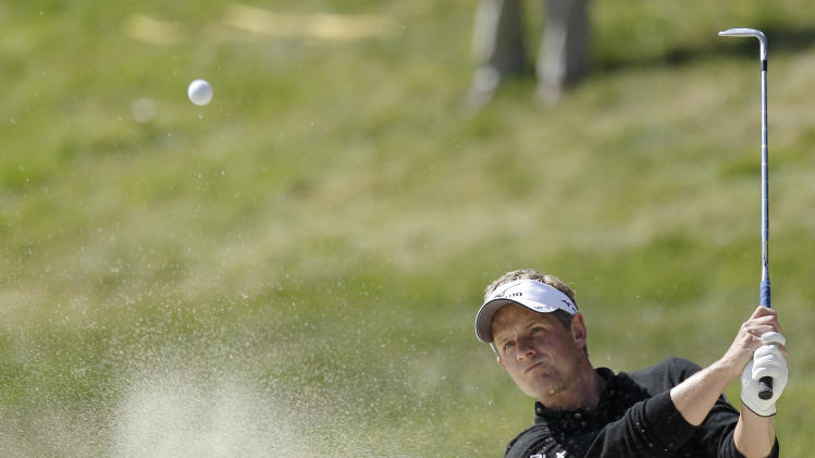Luke Donald, of England, hits out of a bunker on the 17th hole during the second round of the U.S. Open Championship golf tournament Friday, June 15, 2012, at The Olympic Club in San Francisco. (AP Photo/Ben Margot)