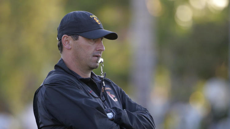Southern California coach Steve Sarkisian watches his players train during NCAA college football practice Wednesday, Aug. 20, 2014, in Los Angeles