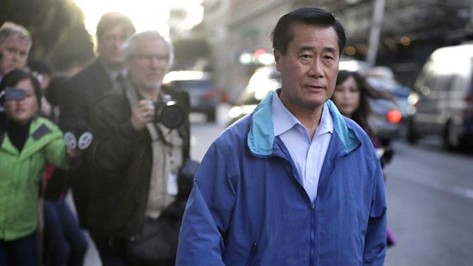 FILE - In this March 26, 2014 file photo, California state Sen. Leland Yee, D-San Francisco, right, leaves the San Francisco Federal Building in San Francisco. Yee, a California state senator and more than two dozen others have been formally indicted in a sweeping San Francisco political corruption case, officials announced Friday April 4, 2014. (AP Photo/Ben Margot,File)