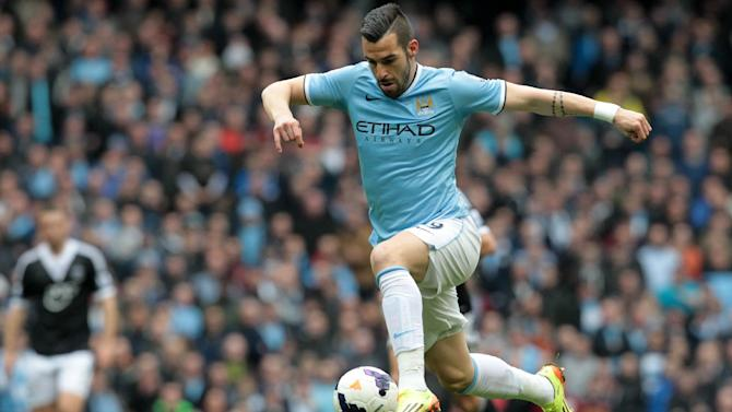 Spanish striker Alvaro Negredo takes the ball upfield during a match in Manchester, northwest England, on April 5, 2014