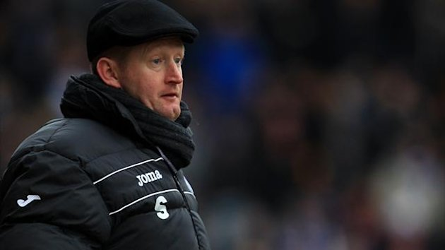 Steve Lomas says his side's clash at a storm-lashed Pittodrie should have been postponed