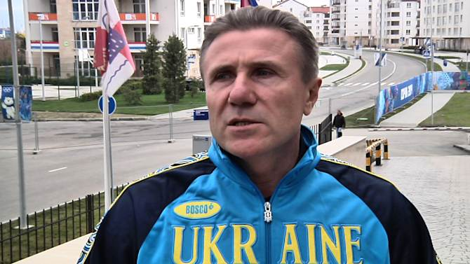"""Ukrainian pole vault great Sergei Bubka is interviewed outside the headquarters hotel of the International Olympic Committee, at the 2014 Winter Olympics, in Sochi Russia on Wednesday, Feb. 19, 2014. Bubka appealed Wednesday to both sides in his homeland's political crisis to halt the violence that has claimed dozens of lives and brought the country """"to the brink of catastrophe."""" (AP Photo/Mark Carlson)"""