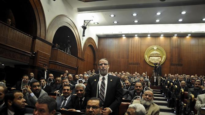 Essam el-Erian vice chairman of the Freedom And Justice party, speaks during a session at the Shura Council building in Cairo, Egypt, Wednesday, Dec. 26, 2012. The official approval of Egypt's disputed, Islamist-backed constitution Tuesday held out little hope of stabilizing the country after two years of turmoil and Islamist President Mohammed Morsi may now face a more immediate crisis with the economy falling deeper into distress. (AP Photo/Mohammed Asad)